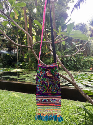 Sad Sa Upcycled Purple Multi Color Printed Festival Crossbody with Hand Beaded Detail and Mini Yarn Tassel Lifestyle