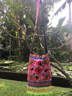 Aelv Upcycled Pink Multi Color Black Bird Printed Crossbody with Hand Beaded Detail and Mini Yarn Tassel Lifestyle