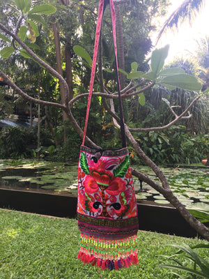 Valahok Upcycled Pink Multi Color Black Bird Printed Festival Crossbody with Hand Beaded Detail and Mini Yarn Tassel Lifestyle