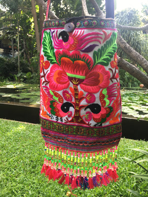 Valahok Upcycled Pink Multi Color Black Bird Printed Festival Crossbody with Hand Beaded Detail and Mini Yarn Tassel Close Up