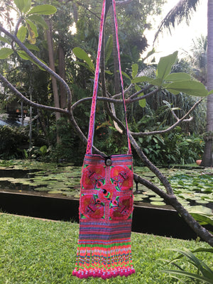 Namtok Upcycled Pink Multi Color Printed Festival Crossbody with Hand Beaded Detail and Mini Yarn Tassel Detail Lifestyle