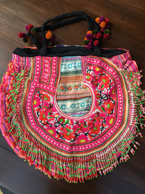 Savan Upcycled Pink Printed Circle Shoulder Bag with Hand Beaded and Pom Pom Details Lifestyle