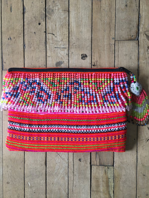 Fa Multi Color Hmong Textile Clutch with Hand Beaded Tassel Detail and Hand Beaded Keychain Lifestyle