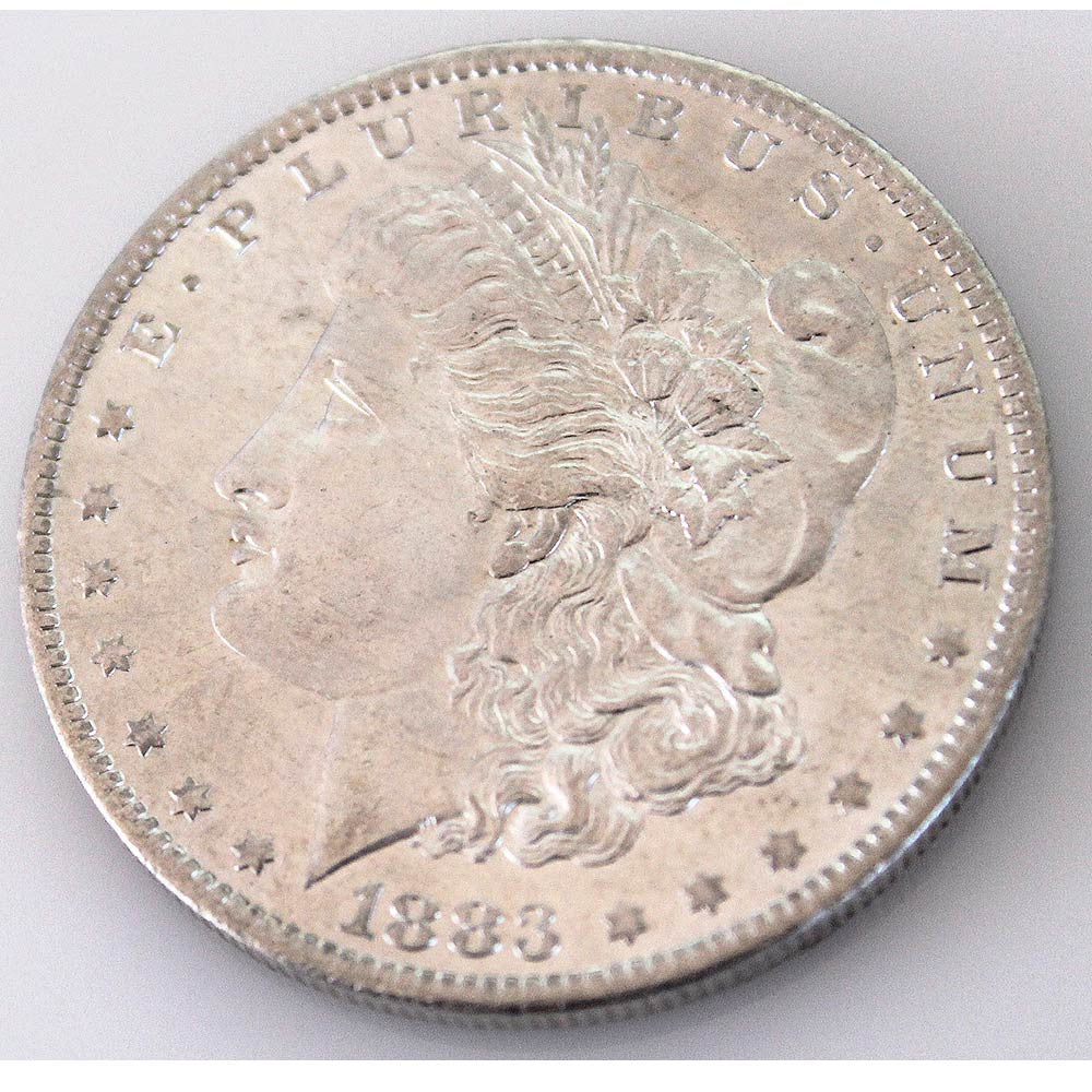 1883-O Morgan Silver Dollar (side) from AntiqueDigger.com