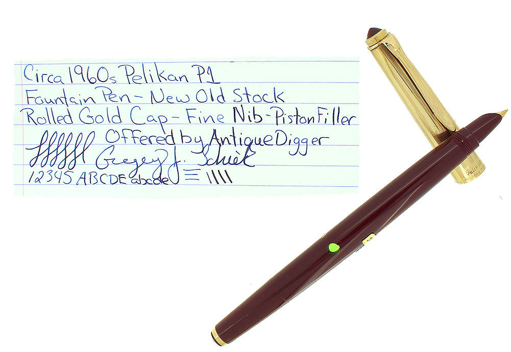 CIRCA 1958 PELIKAN P1 ROLLED GOLD CAP BURGUNDY BARREL FOUNTAIN PEN NOS STICKERED OFFERED BY ANTIQUE DIGGER