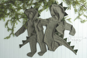 green hooded dinosaur in Sitter and Newborn