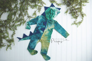 Newborn blue and green hooded dinosaur with blue spikes