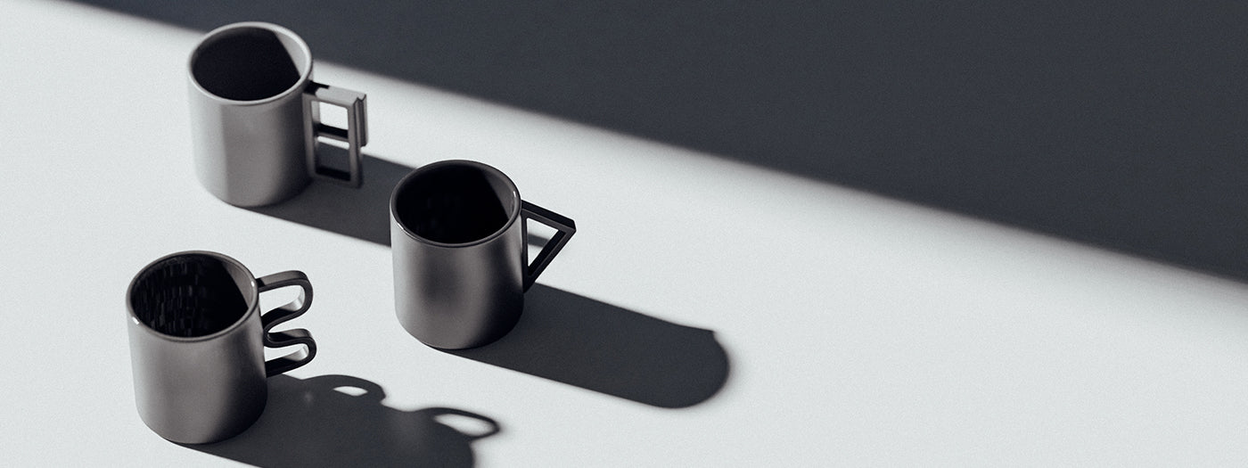 Three grey Aandersson Shapes mugs on a grey background
