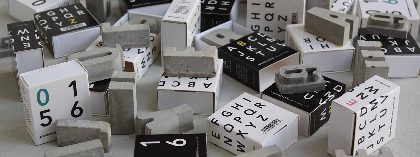An Artful Life concrete letters and numbers in matchbox style gift boxes