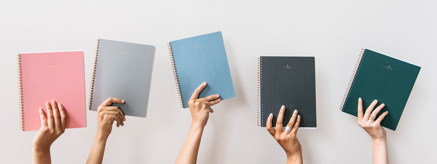 Appointed planners and diaries being held up in various colours