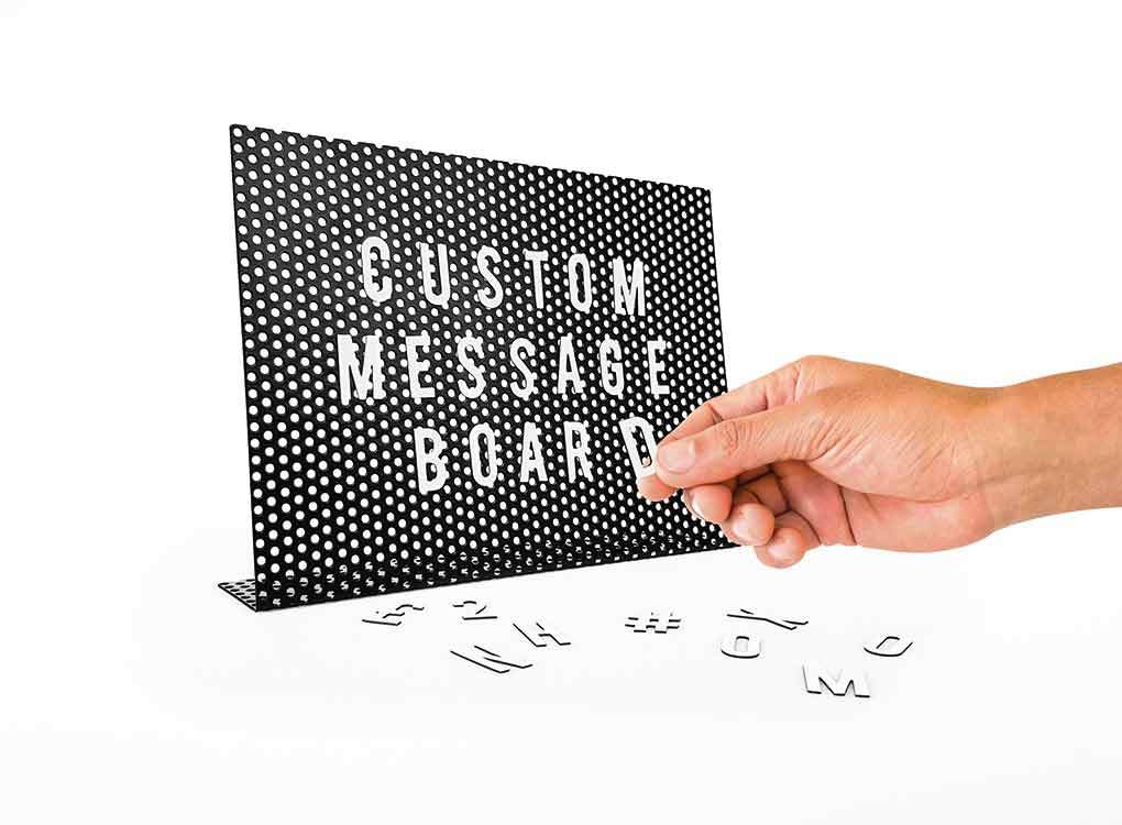 Magnetic message board with letters being customised to say custom message board