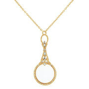 Gold Tone Crystal Accented Magnifying Glass Necklace 28 In