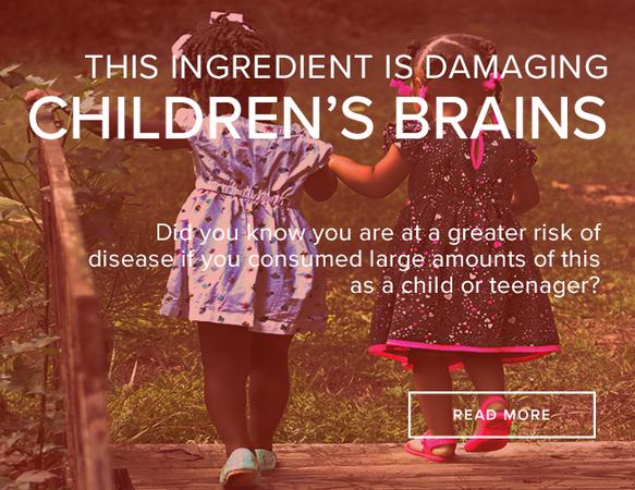"Little black girl wearing a blue spotted dress and a little white girl wearing a black dress with pink dots are holding hands as they cross a bridge to a grassy field. The image reads, ""The ingredient is damaging children's brains."""