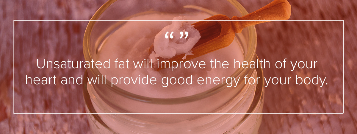 "A clear container filled with a white, cream like substance is being scooped out with a wooden spoon. The image reads: ""Unsaturated fat will improve the health of your heart and will provide good energy for your body."""
