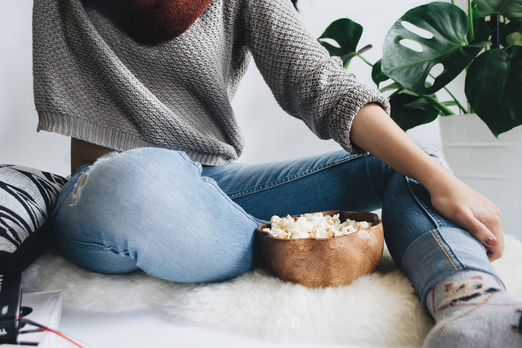 cozy woman eats popcorn