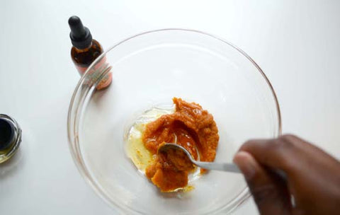 Mixing together raw honey and pumpkin puree for the seabuckwonders beauty mask