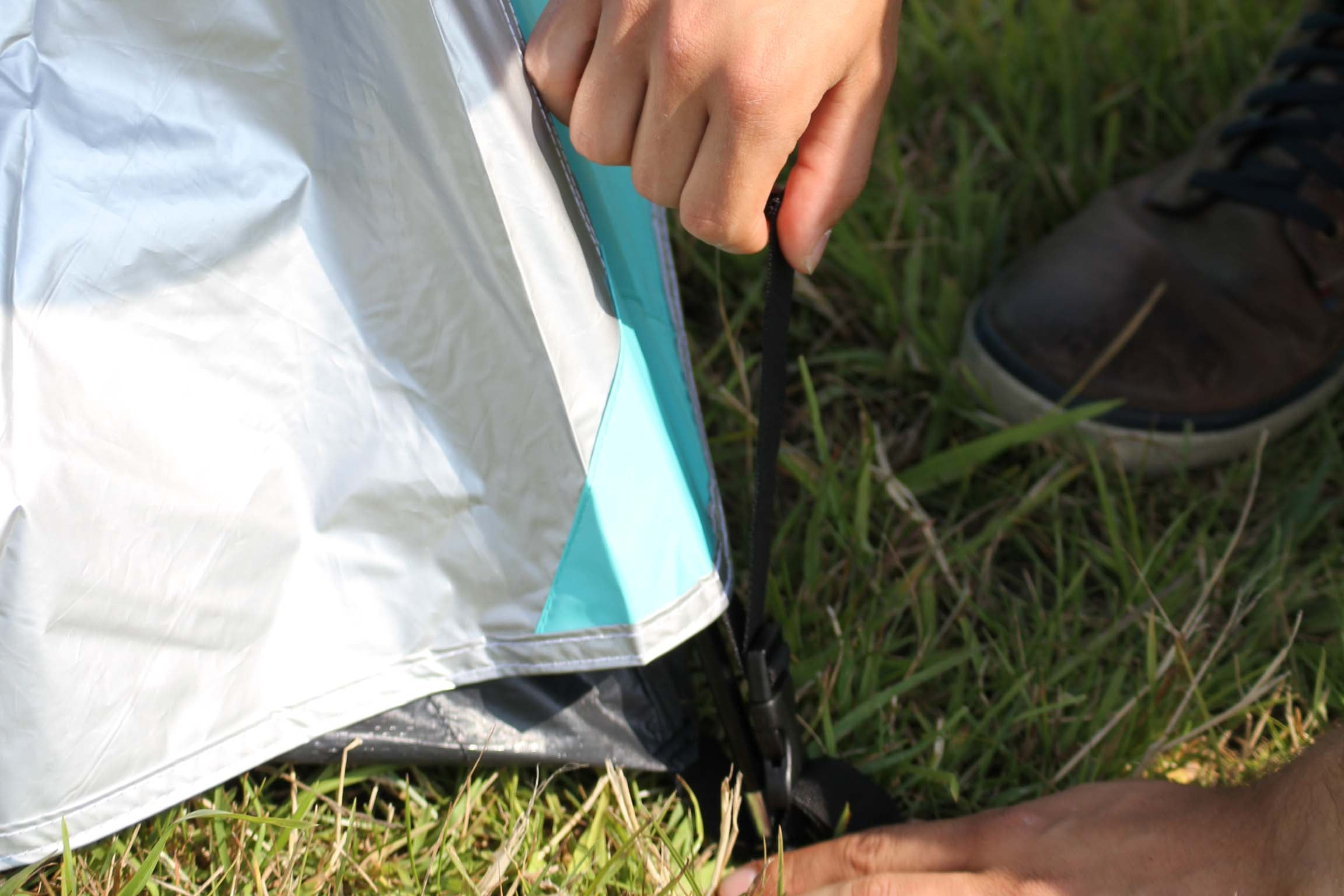 Tighten the straps to secure the outer tent