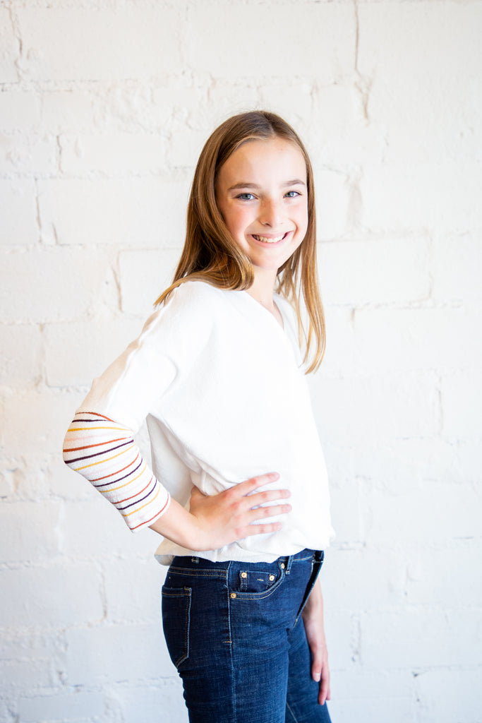 girl's top, tween top, t-shirt, longsleeve t-shirt, long sleeve t-shirt, striped sleeve t-shirt, ivory t-shirt, multi striped sleeve t-shirt, Dallas boutique, tween boutique, teen girl's boutique, little girl's boutique