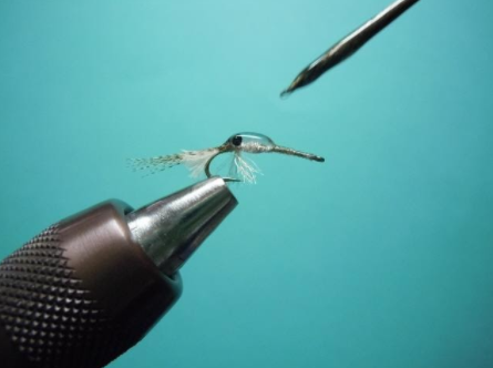 Shaping the epoxy of lure.