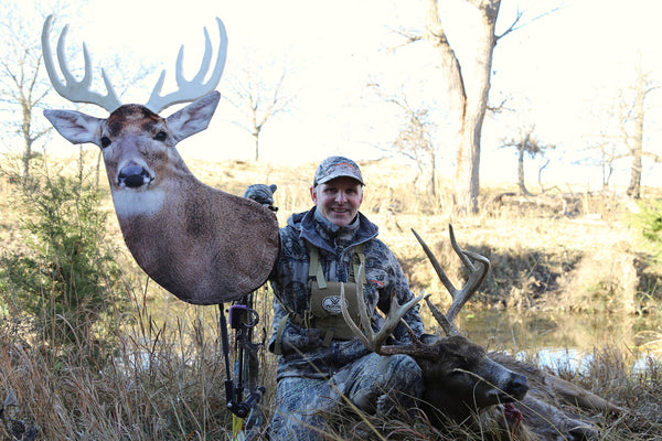 whitetail buck take with bow mounted heads up decoy