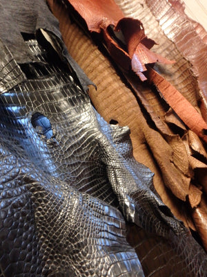 Custom orders with alligator skins into leather accessories