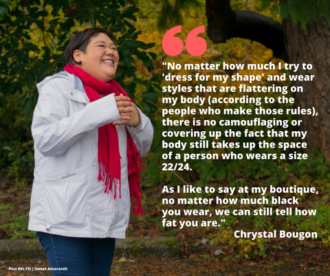 [Image description: A plus-size Asian-American woman laughs in a park with trees behind her and her hands clasped in front of her. She's wearing blue jeans, a white coat and a red scarf.]