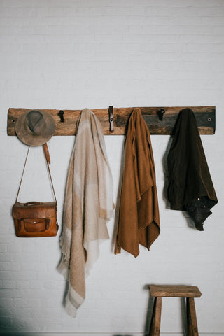 Live edge rack perfect for hat storage.