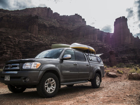SUV with Kayaks parked in Fish Tower campground.