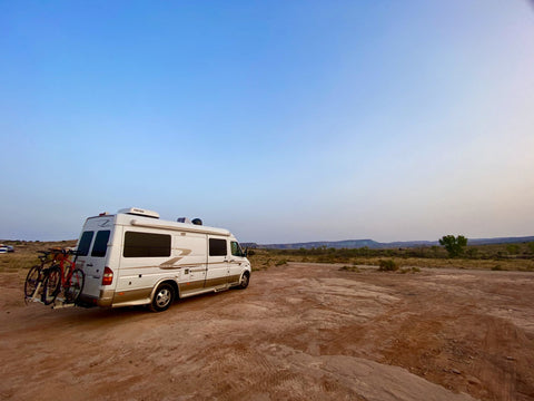 Van parked in the desert at a campground outside of Arches National Park.