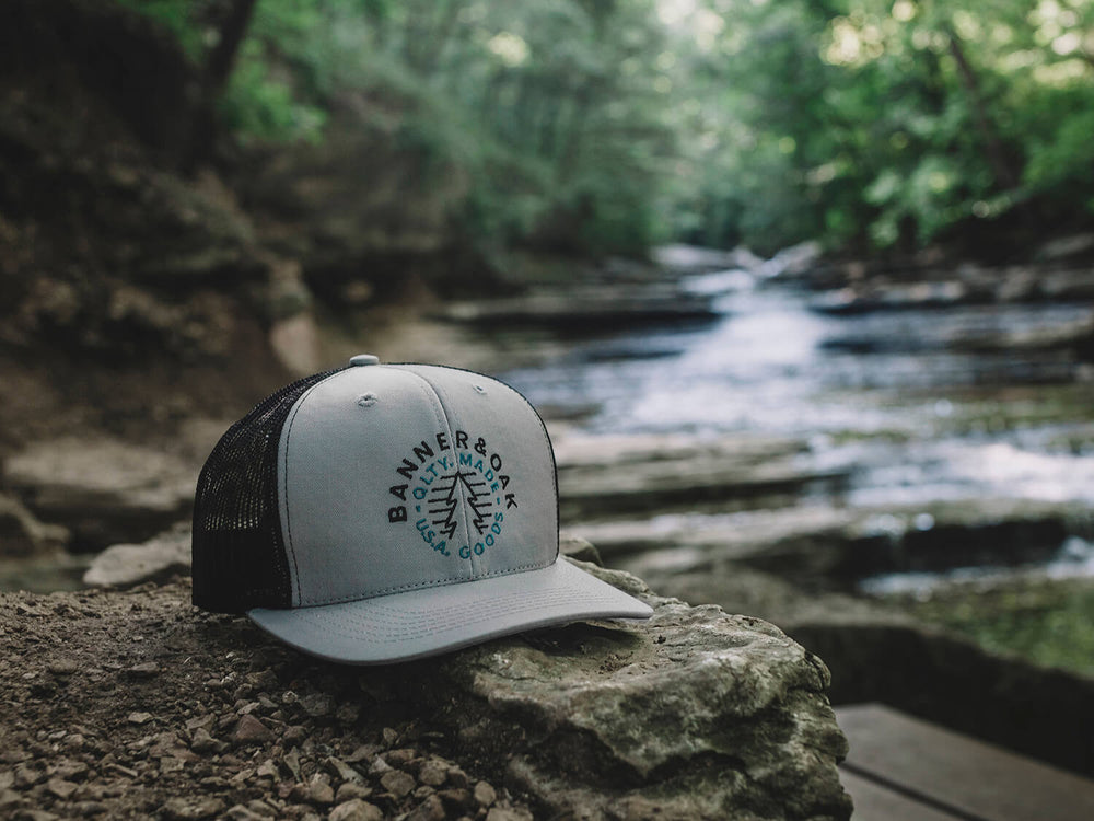 Evergreen Embroidered Snapback Trucker Hat Gray Lifestyle Image
