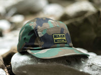 Trailhead Woven Label Patch Cap Camo Lifestyle Image