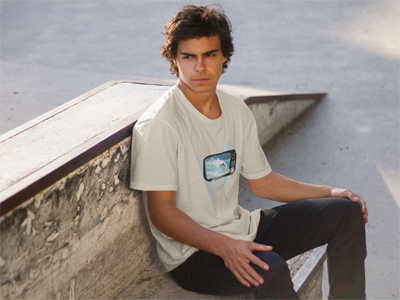 Young man wearing TUBE TV design over a sand premium fitted short sleeve crew neck tee. Super-soft 100% combed ring-spun cotton high-end jersey 4.3 oz. from Panama Surf® brand apparel line.