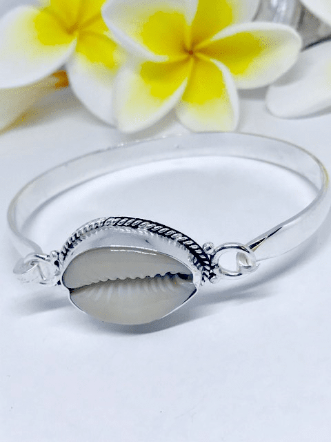 Natural white cowrie shell in sterling silver bangle 6.5 cm diameter with opening clasp.