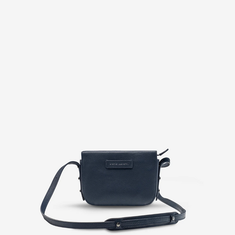 STATUS ANXIETY IN HER COMMAND LEATHER CROSSBODY BAG NAVY BLUE