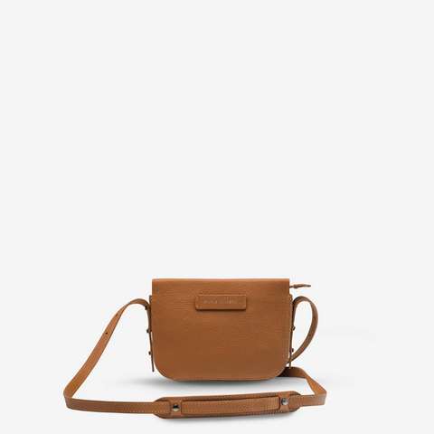 STATUS ANXIETY IN HER COMMAND LEATHER CROSSBODY BAG TAN