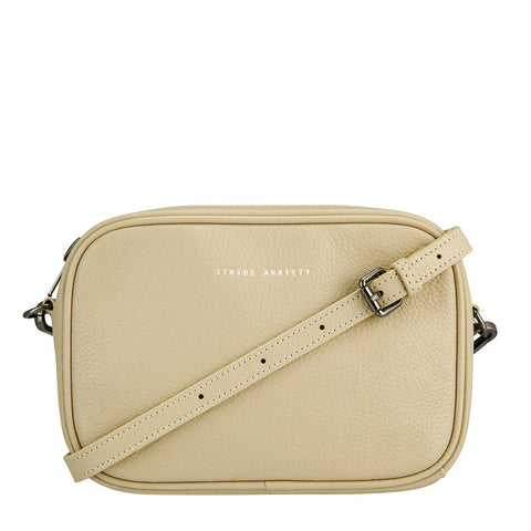 STATUS ANXIETY PLUNDER LEATHER CROSSBODY BAG NUDE BEIGE