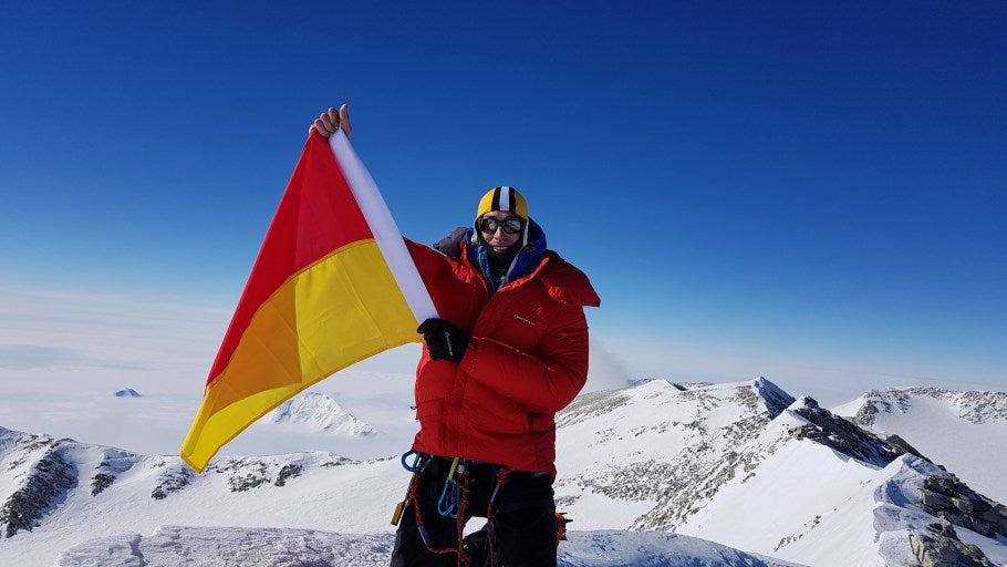 Steve Plain Project 7in4 - summit Mt Vincent with Surf Lifesaving Flag
