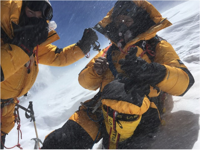 Chris Burke and Lakpa Sherpa share the small area on the summit of Annapurna