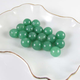 "11- 12mm green quartz (dyed) round beads, 7"" strand, 17 beads"