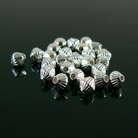 5mm silver plated brass corrugated bi-cone beads, 25 pieces. 1.2mm hole.