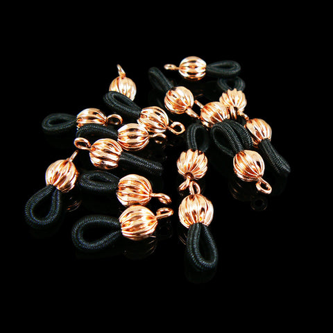Black eyeglasses ends with copper plated ball, 24 pcs.