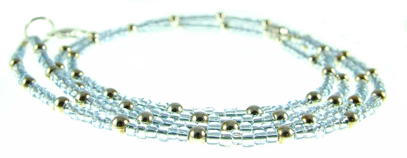 Size 8/0 transparent light blue Matsuno glass seed beads, 20 grams, approx. 600 beads