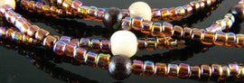 Size 8/0 transparent rainbow root beer Matsuno glass seed beads, 20 grams, approx. 600 beads