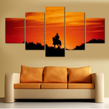 cowboy horseback riding during sunset wall art canvas 2