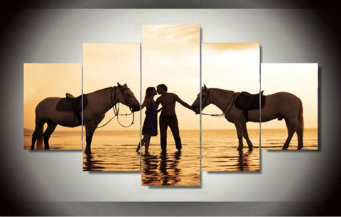couple kissing with horses during sunset wall art canvas
