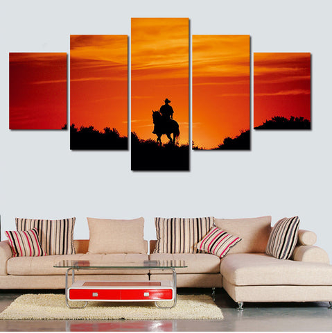 cowboy horseback riding during sunset wall art canvas