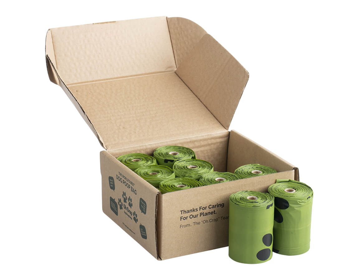 An image of the left hand side of the Oh Crap Non Plastic Compostable Biodegradable Dog Poop Bags 6 Month Pack box with rolls in front