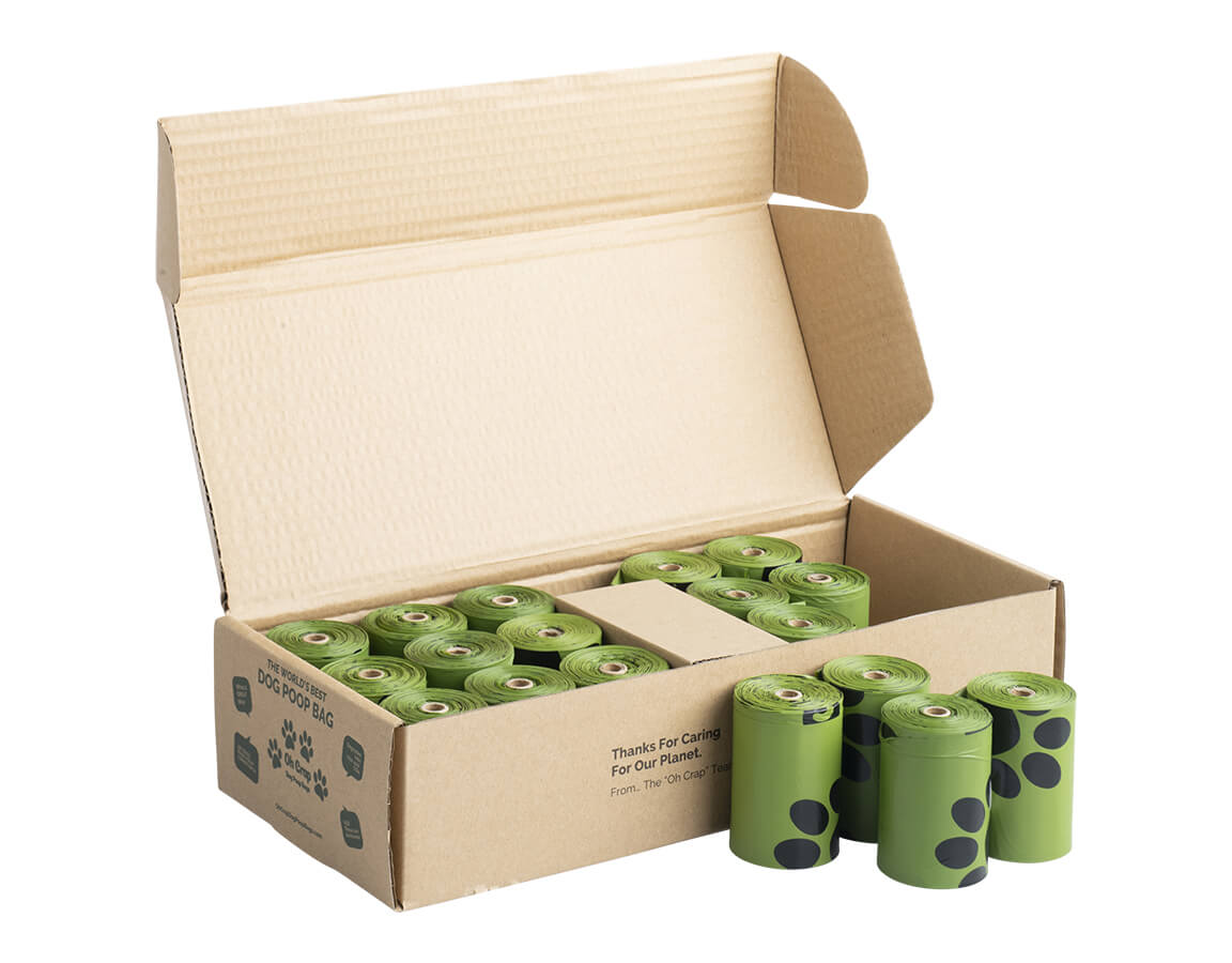An image of the left hand side of the Oh Crap Non Plastic Compostable Biodegradable Dog Poop Bags 12 Month Pack box with rolls in front of it