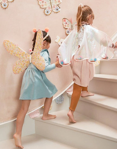 Little girls wearing dressing up clothes including Meri Meri butterfly dress up kit