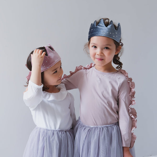 Two little girls wearing velvet fabric crowns by Mimi & Lula